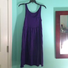 Purple Gap casual cotton dress This dress is light and airy and a beautiful deep purple color. It is in fantastic condition, barely worn. There is a small pocket on the front and pockets on the side. This dress is great for spring and summer! The size is XS but it could probably fit a small or medium GAP Dresses