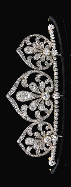 DIAMOND TIARA/NECKLACE, CIRCA 1910 The graduated open work spade-shaped motifs set with cushion-shaped, circular-, single-cut and rose diamonds, set along a row of similarly cut stones, spade motifs and line of diamonds detachable, accompanied by additional fittings including original screw driver, fitted case stamped F. Kandelhart, Juwelier, Wien VII, Zollergasse 35.