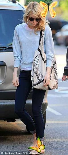 That's Superbad behaviour! Emma Stone fools around with film boss Judd Apatow as they enjoy a lunch meeting blue light sweater, skinny jeans, and a flat shoes. (Emma Stone)<br> The 24-year-old was spotted outside Bubby's restaurant in the Big Apple with the 45-year-old.