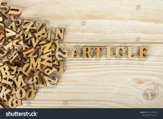 Writing articles. From the pile of letters to create the text for the press. Wooden letters on a wooden background. The view from the top.