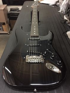 G&L Musical Instruments Legacy in Blackburst over swamp ash, 1-ply black guard, black covers and knobs, rosewood board