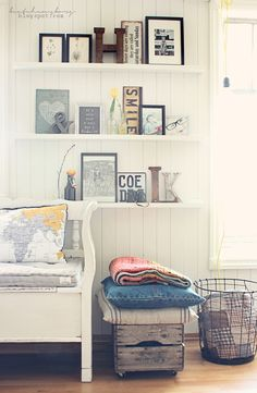 I like the idea of placing everything on shelves instead of hanging on the wall. Living
