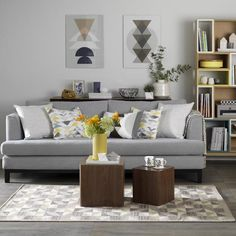 Grey living room with retro textiles in shades of mustard and teal