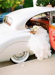We love this old-fashioned car!   These are great for a getaway car or to arrive to the ceremony in!