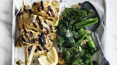 Turmeric fish skewers and garlic greens.