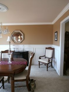 "Dining room re-do.... crown molding, faux wainscoting, detailed chair rail. Wall paint color ""Soft chamois"" by Behr."