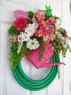 Spring wreath- the hose.  How cute.  How to use all of Gpa's 50 hoses :)