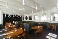 An Artful Restaurant for the Basel Bound: Remodelista. Love the lights!