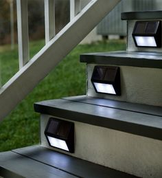 Set Of Four Solar Step Lights: These would be great for the front steps at our new house - or the steps to the back deck :) outdoor deck Solar Step Lights, Solar Lights For Deck, Outdoor Step Lights, Path Lights, Exterior Solar Lights, Outdoor Battery Lights, Fairy Lights, Luz Solar, Solar Led
