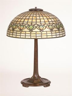 """iffany Studios Pomegranate Table Lamp  Leaded glass shade with pomegranate band, signed """"TIFFANY STUDIOS - NEW YORK"""" to interior of bottom rim; on a bronze footed standard, base marked """"TIFFANY STUDIOS - NEW YORK - 533 #tiffany #decarts Tiffany, Leaded Glass, Led Lamp, Art Decor, Home Decor, Glass Shades, Pomegranate, Studios, Auction"""