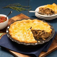 While traditionally made with pork or beef, our version uses the dark meat of chicken thighs, as well as ground chicken, for an equally delicious take on this classic Quebecoise dish. La Tourtiere, Chicken Mashed Potatoes, Mushroom Pie, Cooked Apples, Canadian Food, Ground Chicken, Mets, Chicken Seasoning, Stuffed Hot Peppers