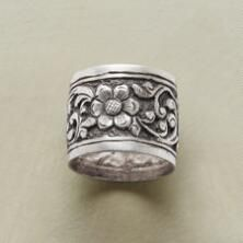 The lovely play of light and shadow is captured on this gorgeous, sterling silver floral wide band ring.