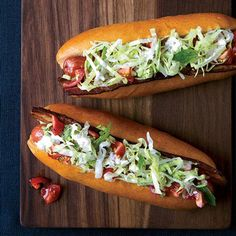 "BLT Hot Dogs with Caraway Remoulade Recipe | These ""BLT"" hot dogs are topped with crispy bacon, fresh tomatoes, and crunchy lettuce dressed with a creamy caraway-pickle mayonnaise."