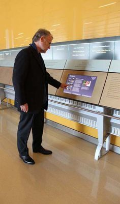 UCM donor wall and interactive kiosk at the Center for Care and Discovery designed by Cloud Gehshan Associates