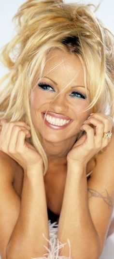 Pamela Anderson- her makeup Is a beautiful creation.