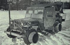 Early Willys MB with mud flotation adaptors