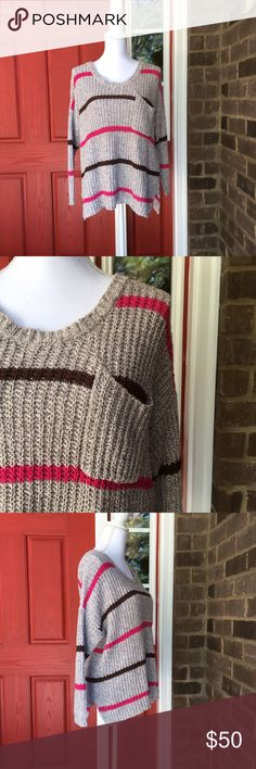 Free People Oversized Striped Sweater Made from a cotton/rayon blend, this oversized sweater from Free People is incredibly soft. The grey, pink, and brown stripes are a fun twist on a classic. In excellent condition. 10507 Free People Sweaters