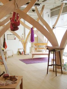 Interesting plywood trees as decor in an upper level apartment