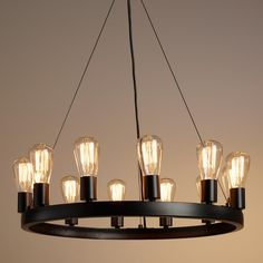 Crafted of iron with an industrial-style black finish, our exclusive round chandelier fills a room with the rustic warmth of 12 Edison lights - included for a brilliant value. >> #WorldMarket Home Decor, Lighting
