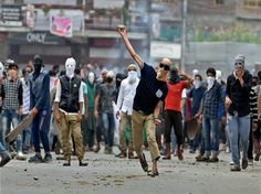 Protesters throwing stones at police during a clash which erupted after police…