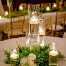 Greg and Jess Photography The reception tables were decorated with white table lines, floating candles inside cylinder hurricane vases and lush florals. Venue / Coordinator: East Ivy Mansion #floatingcandles
