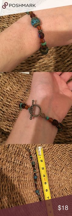 SALE Turquoise and brown beaded bracelet Worn a couple times but is in great condition. Works great for summer time! Jewelry Bracelets