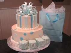 - French Buttercreme with fondant accents, bow and baby blocks.  Not all of the letters are visible, but the baby's name is Cooper.