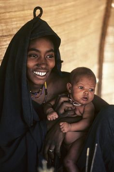 No matter what culture, a mother's love is unconditional. Love that baby's face!!