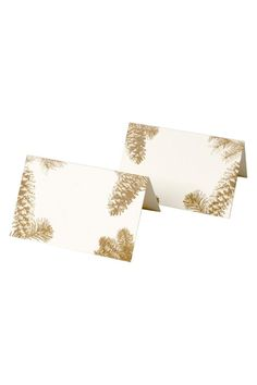 """Set of 12 double-sided tented place cards. High quality thick paper that is made of recycled materials. An elegant way to create beautiful seating arrangements. Designed & Made in the USA.    Size: 2.5"""" x 3.5"""" (folded)   Pinecone Place Cards by Lavender Blue. Home & Gifts - Home Decor - Dining - Table Accessories Los Angeles, California"""