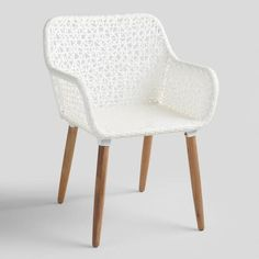 With its intricate white wicker weave and acacia wood legs with a natural oil finish, our dapper Blanca armchair strikes a stunning pose.