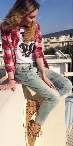 Actress Athina Oikonomakou wearing #MIGATO XN5993 tobacco sneaker with fringes! SHOP NOW ► miga.to/XN5993-L52en