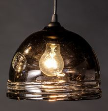 Our hand blown pendant lighting has a unique ribbed base that brings a rustic elegance to any space. www.FrostGlass.com