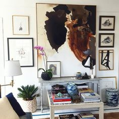 Instagram Home Tour: William McLure's Birmingham Pad—Not only a designer, he's also a talented artist. In this particular gallery wall, the large abstract piece of art is a McLure original that pairs nicely with smaller works in the same color scheme.