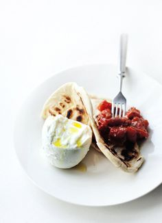 Flatbreads with garlicky tomatoes and mozzarella
