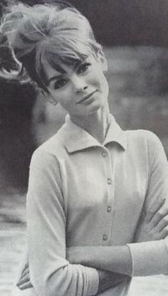 Jean Shrimpton wears a classic cardigan.