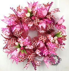 Deco Mesh Valentines Wreath in Hot Pink and Red with Tulips -Door Wreath -Valentines Day Decor -Deco Mesh Wreath by www.southerncharmwreaths.com #diy #valentines #party