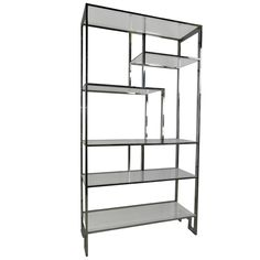 Chrome etagere - I have so much fun accessorizing a big shelving piece like this!