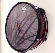 "mahogany repurposed snare drum turned into wall clock called ""moonlight jam""."