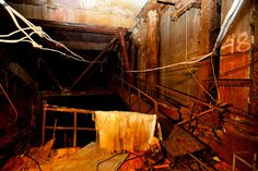For years desperate efforts were under way to shore up the roof of the shelter to prevent it from collapsing. Inside the sarcophagus, dimly lit tunnels lead to eerie rooms strewn with wires, pieces of shredded metal and other debris. Walls have collapsed, and rubble is covered with contaminated dust. The stabilization work has been completed, and today the reactor's interior sits untouched and deadly radioactive, waiting to be dismantled.  Chernobyl Nuclear Power Plant, Ukraine, 2011