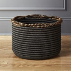 Free Shipping.  Shop Amber Coiled Rope Basket.   Handwoven cords of seagrass and plastic coil tightly around, making remotes/books/magazines disappear.  Top is wrapped with paper thread to create a thick serpentine rim.