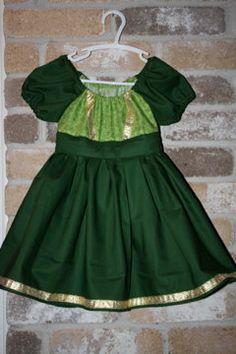 Celtic Princess?   Princess Fiona from Shrek?  Princess Merida from Brave?  Love the dark green with gold ribbon details!