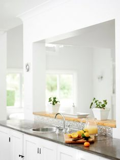Like: pressed tin behind sink, white  Dislike: window through to living area