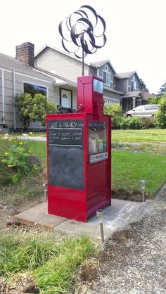 I bet your town has a few of these lying around. Try acquiring one, adding chalkboard paint to the side and turning it into a Little Free Library!