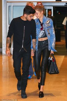 Pillowtalk! The duo chatted intimately at the airport...