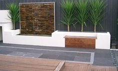 Water Wall with Black Lava Stone Paving & Pebbles