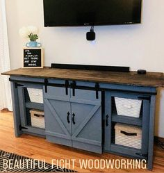 We are loving this barn door farmhouse entertainment center! it is the perfect addition to your farmhouse style. this four door, sliding barn door cabinet Western Furniture, Farmhouse Furniture, Rustic Furniture, Living Room Furniture, Home Furniture, Modern Furniture, Outdoor Furniture, Living Rooms, Farmhouse Cabinets
