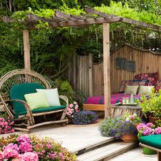 outdoor bed under vine covered pergola, rustic chair and beautiful flowers