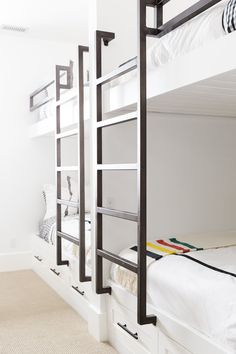 Studio McGee - Beautiful black and white bunk beds with fun pillows in a bunk room spaces decor
