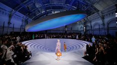 When it comes to London Fashion Week theatrics, Anya Hindmarch is renowned for her high-tech sets – from flashing lights to moving runways – but this season the designer quite literally broke through her own glass ceiling