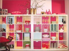 I absolutely love this. We have 1 of these IKEA shelves (but now I want 2!). Notice how they decorated the backs of each cubby. Some match the wall, and some are fun prints. Could do some awesomely cute storage for kid's bedroom or playroom, especially if you get the bins, too